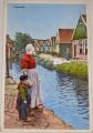 Holandsko:  Volendam  dobový život u vodních kanálů (cca 1910)